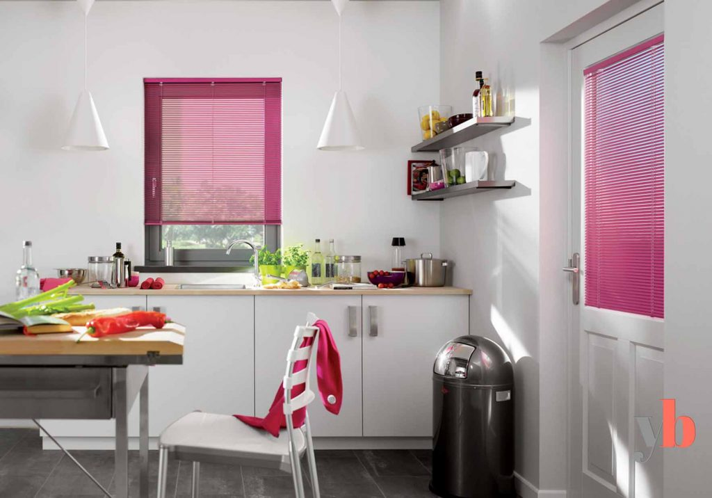 Pink blinds in kitchen