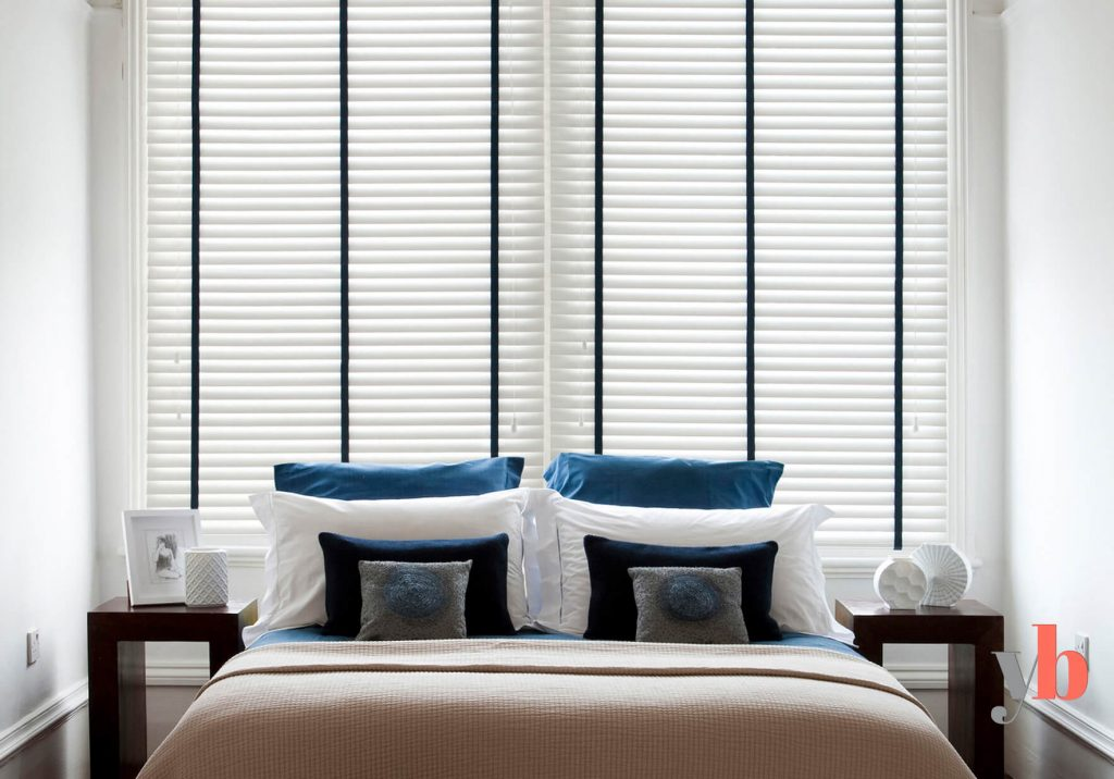 White Venetian Blinds with black tapes