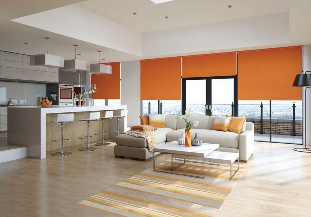 Motorised roller blinds in open plan living area