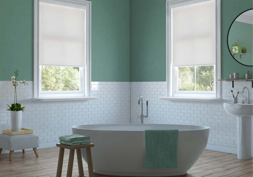 Whiite roller blinds in the bathroom
